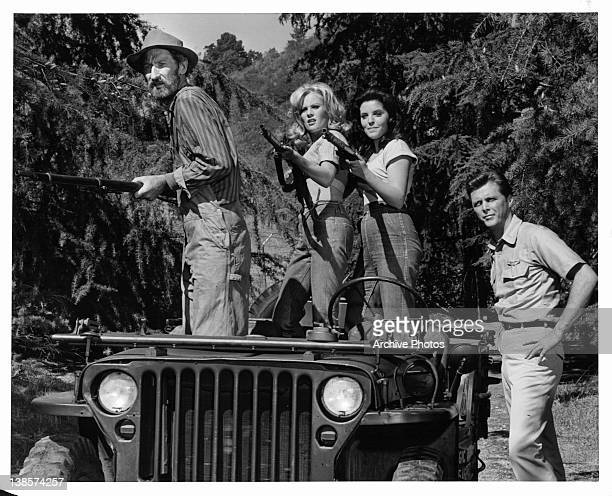 Unidientified man Susan Seaforth and Pamela Austin aiming their weapons on a jeep as Edd Byrnes watches in a scene from the television series...