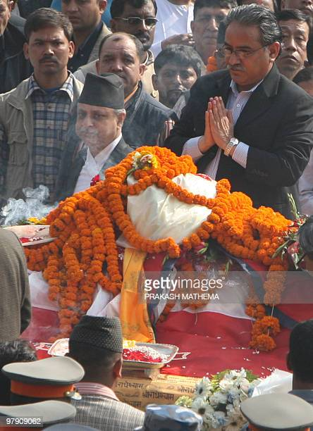 Unified Communist Party of Nepal chairman Pushpa Kamal Dahal also known as 'Prachanda' pays his last respect to Nepali Congress president and former...