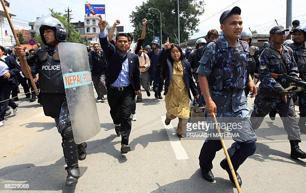 Unified Communist Party of Nepal lawmakers chant slogans against India and against Nepal's President Ram Baran Yadav during a protest in front of the...