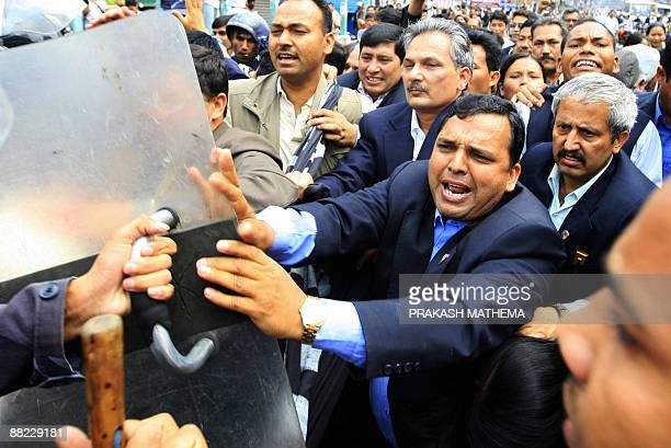 Unified Communist Party of Nepal lawmakers tussle with police during a protest in front of the government administrative building in Singha Durbar in...