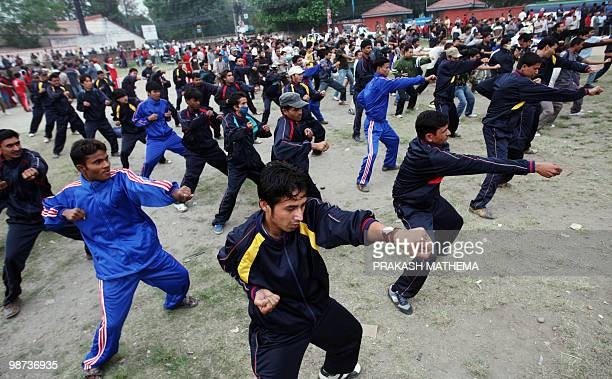 Unified Communist Party of Nepal men cadres take part in physical training in Kathmandu on April 29 2010 Nepal's opposition Maoists have mobilised...