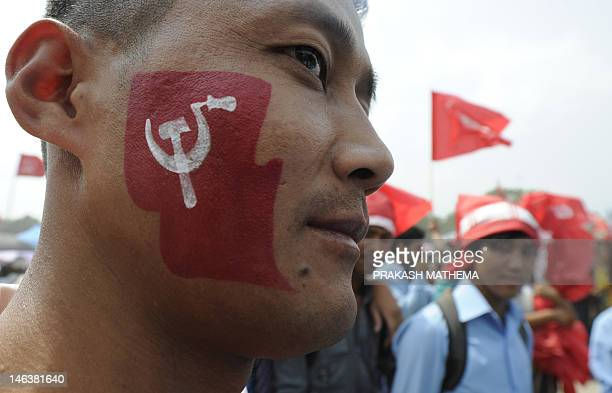 Unified Communist Party of Nepal supporters look on during a mass rally in Kathmandu on June 15 2012 Nepal's ruling Maoists are under pressure from...