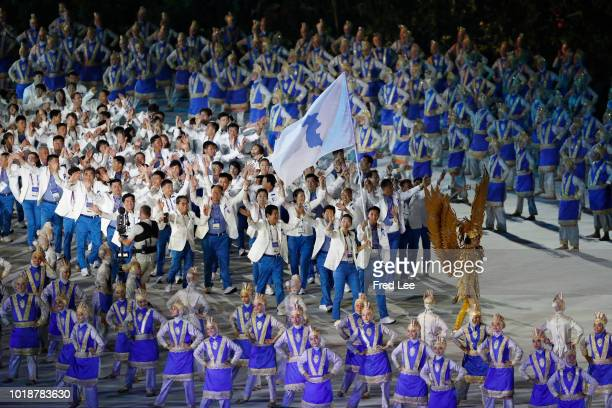 Unified Corea athletes parade during the opening ceremony of the Asian Games 2018 at Gelora Bung Karno Stadium on August 18, 2018 in Jakarta,...