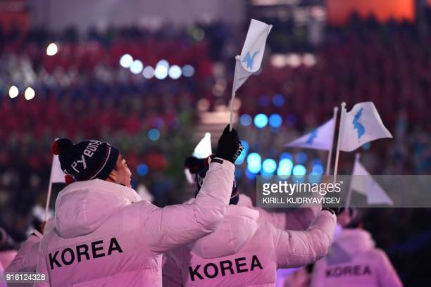 TOPSHOT Unified Korea's athletes parade during the opening ceremony of the Pyeongchang 2018 Winter Olympic Games at the Pyeongchang Stadium on...
