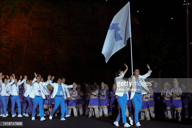 Unified Korea's flagbearer Lim Yunghui leads the delegation during the opening ceremony of the Asian Games on August 18 2018 in Jakarta Indonesia
