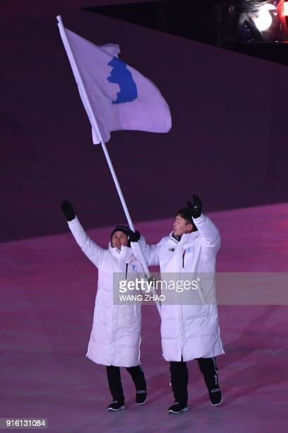 Unified Korea's flagbearers Hwang Chung Gum and Won Yunjong lead the delegation during the opening ceremony of the Pyeongchang 2018 Winter Olympic...
