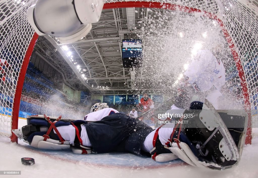 TOPSHOT - Unified Koreas goalie Shin So-jung looks at the puck during the women's preliminary round ice hockey match between Switzerland and the Unified Korean team during the Pyeongchang 2018 Winter Olympic Games at the Kwandong Hockey Centre in Gangneung on February 10, 2018. / AFP PHOTO / POOL / Bruce Bennett