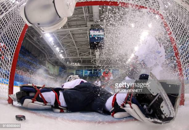 TOPSHOT Unified Koreas goalie Shin Sojung looks at the puck during the women's preliminary round ice hockey match between Switzerland and the Unified...