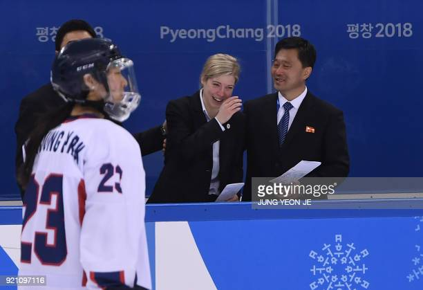 Unified Korea's head coach Sarah Murray reacts after the women's playoff classifications ice hockey match between the Unified Korea team and Sweden...