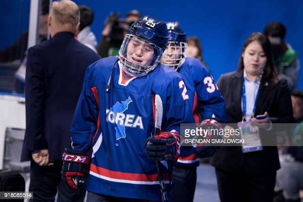 Unified Korea's Lee Jingyu reacts after her teams defeat in the women's preliminary round ice hockey match between Japan and the Unified Korean team...