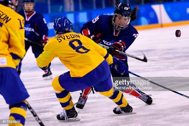 Unified Korea's Lee Jingyu takes a shot in the women's preliminary round ice hockey match between Sweden and the Unified Korean team during the...