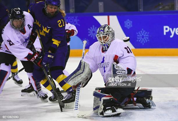 TOPSHOT Unified Korea's Shin So Jung looks on the puck in the women's playoff classifications ice hockey match between the Unified Korea team and...