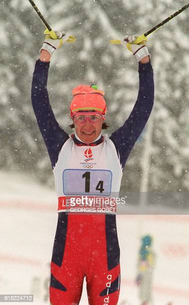 Unified Team cross country skier Ljubov Yegorova jubilates as she crosses the finish line of the women's 4 x 5 km relay 17 February 1992 in Les...