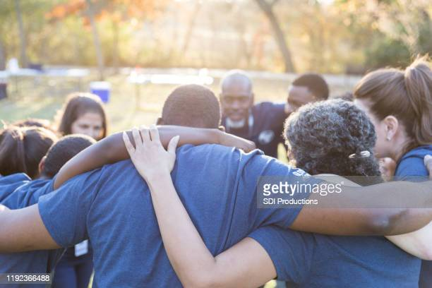 unified team of volunteers - social services stock pictures, royalty-free photos & images