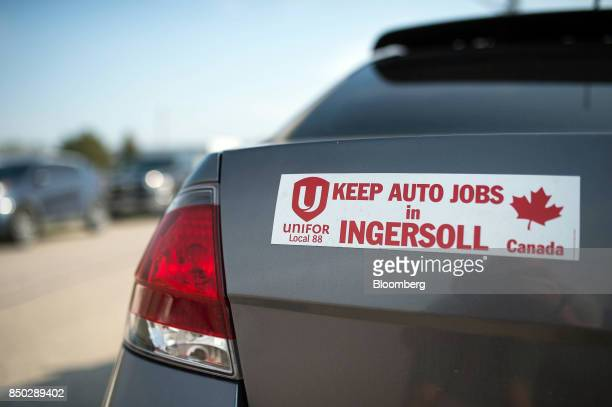A Unifor bumper sticker reading Keep Auto Jobs in Ingersoll is seen on a vehicle outside the General Motors Co plant in Ingersoll Ontario Canada on...