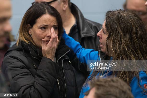 A Unifor union member cries before the press conference with union leaders in Oshawa Ontario on November 26 2018 In a massive restructuring US auto...