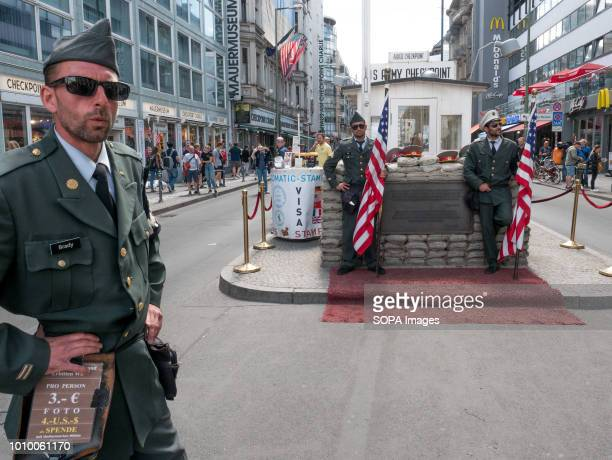 Uniform guys seen at the checkpoint Charlie one of the 3 crossing points between East and West Berlin The Berlin Wall was built by Soldiers in...