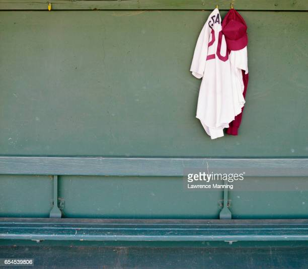uniform hanging above bench - baseball uniform stock pictures, royalty-free photos & images