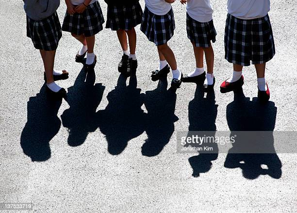 uniformed catholic school girls on the playground. - skirt stock pictures, royalty-free photos & images