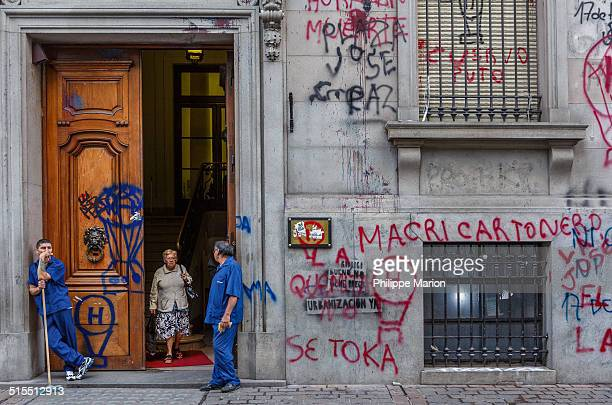 Uniformed cleaning staff at Argentinian government administrative office in Buenos Aires enjoy a morning break The building was a recent target of...