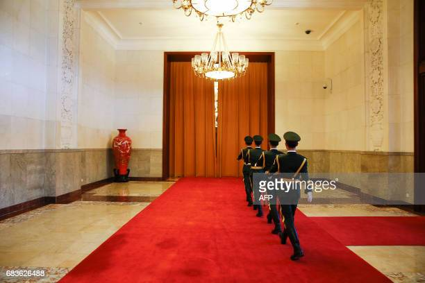 TOPSHOT Uniformed guards march inside the Great Hall of the People where China's President and Prime Minister were meeting visiting leaders in...