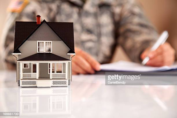 Uniformed Personel with Real Estate Paperwork