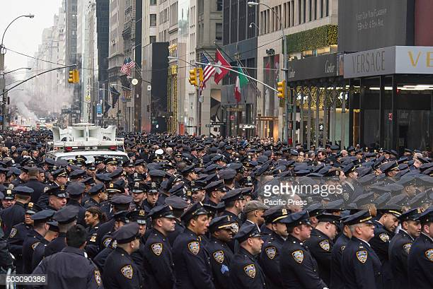 S CATHEDRAL NEW YORK UNITED STATES Uniformed police officers stand at attention as the hearse bearing Joseph Lemm's remains nears the cathedral...