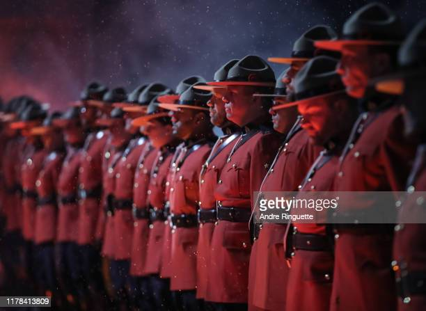 Uniformed Royal Canadian Mounted Police officers line up in a Wall of Honour before the Calgary Flames take on the Winnipeg Jets during the 2019 Tim...
