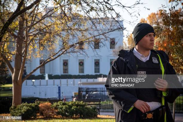 A uniformed Secret Service officer patrols the grounds at the White House in Washington DC on November 26 during a lockdown following an air space...