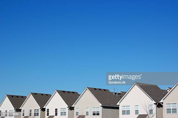 uniformity in housing - in a row stock pictures, royalty-free photos & images