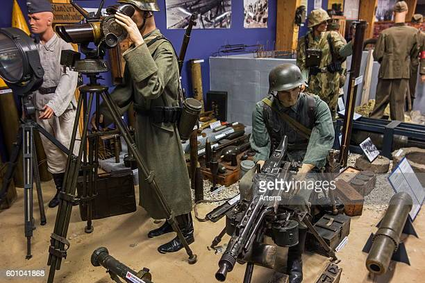 Uniforms and weapons of German soldiers at the Musee Memorial d'Omaha Beach WW2 museum about DDay at SaintLaurentsurMer Normandy France