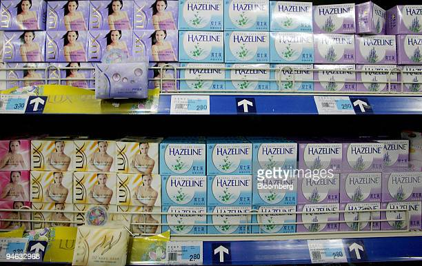 Unilever Plc's Lux and Hazeline brand soaps are displayed at a supermarket in downtown Beijing China on Tuesday October 10 2006