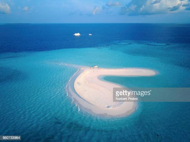 Uninhabited sandbank with tourists, island in the coral reef, diving boats in the back, Ari atoll, Indian Ocean, Maldives