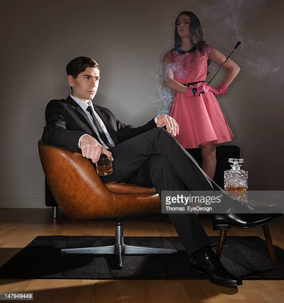 uninterested husband - women whipping men stock photos and pictures