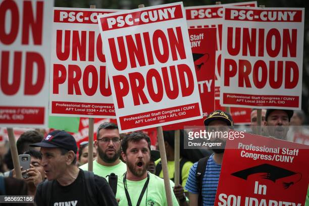 Union activists and supporters rally against the Supreme Court's ruling in the Janus v AFSCME case in Foley Square in Lower Manhattan June 27 2018 in...