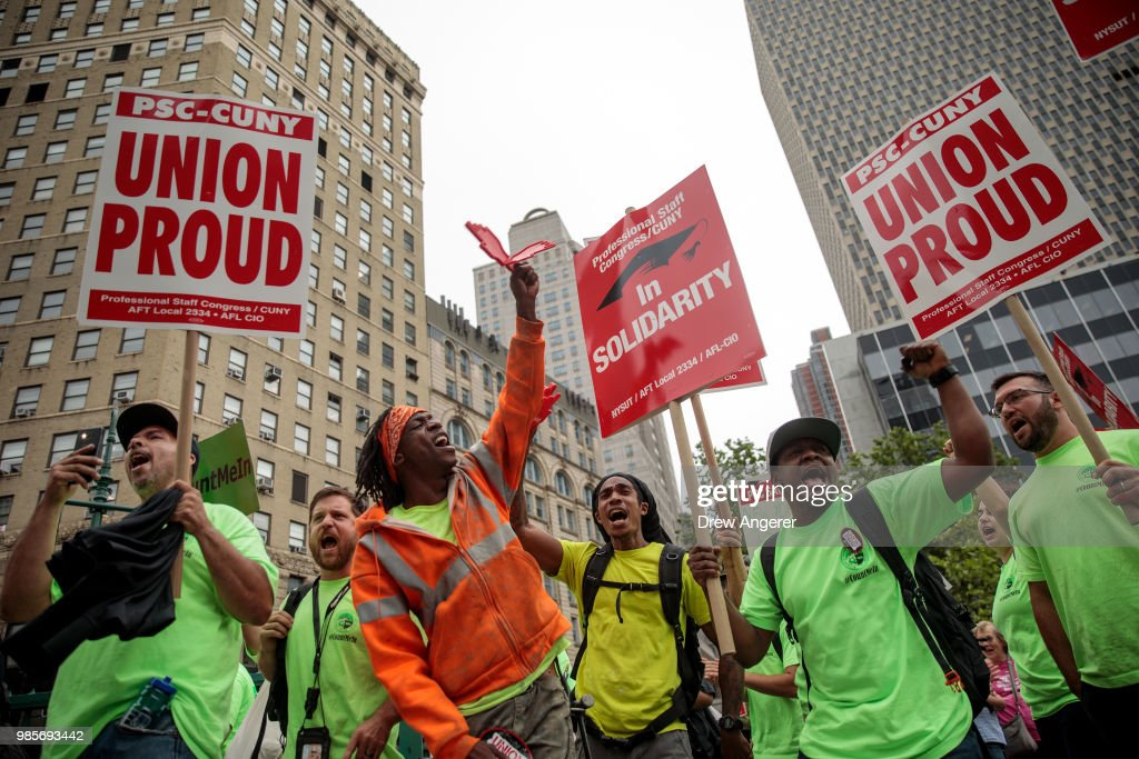 Union activists and supporters rally against the Supreme Court's ruling in the Janus v. AFSCME case, in Foley Square in Lower Manhattan, June 27, 2018 in New York City. In a 5-4 decision, the Supreme Court ruled on Wednesday that public employee unions cannot require non-members to pay fees. The ruling will have significant financial impacts for organized labor.