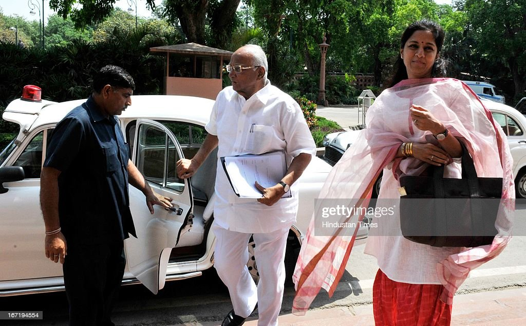 Union Agriculture Minister Sharad Pawar and his daughter and MP Supriya Sule arrive at Parliament to attend Parliament Budget Session on April 22, 2013 in New Delhi, India. Parliament saw a stormy start to the second half of the Budget session today with issues including coal scam, incidents of rape and alleged heckling of Mamata Banerjee rocking both Houses.