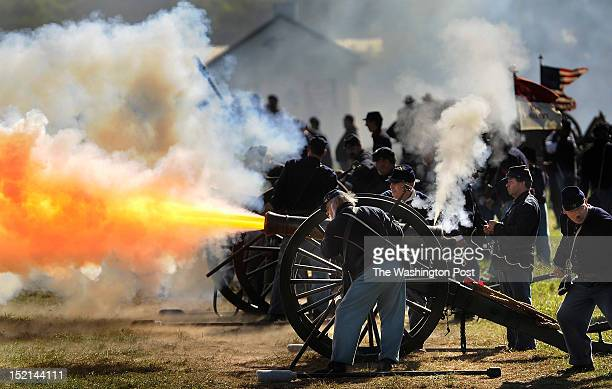 Union Army Reenactors take part in a recreation entitled Dunker Church as people gather to mark the 150th anniversary of the Battle of Antietam on...
