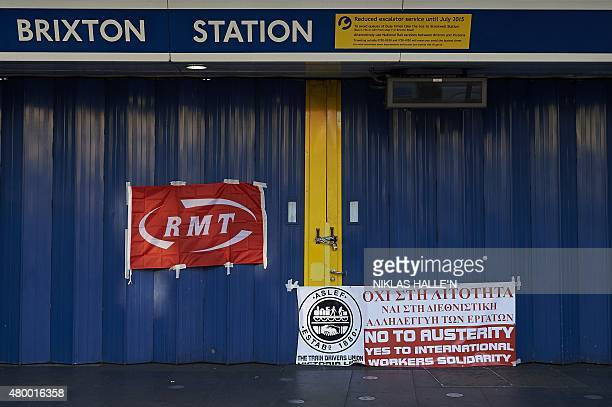 Union banners on display outside the closed gates of Brixton underground station during a tube strike in London on July 9 2015 London's roads buses...