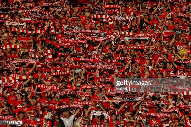Union Berlin fans enjoy the atmosphere during the Bundesliga match between 1 FC Union Berlin and Borussia Dortmund at Stadion An der Alten Foersterei...