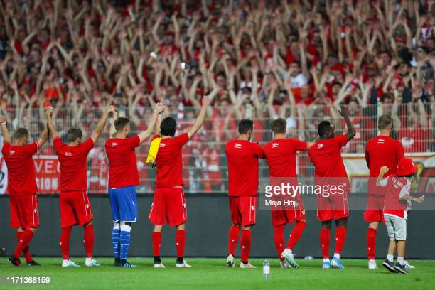 Union Berlin players celebrate at the end of the Bundesliga match between 1. FC Union Berlin and Borussia Dortmund at Stadion An der Alten Foersterei...