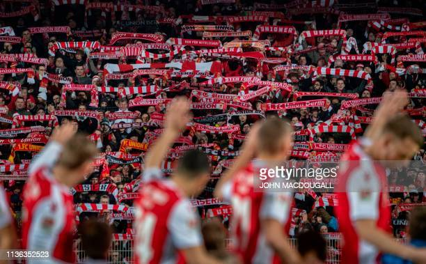 Union Berlin players wave as supporters display their scarves prior to the 2nd division Bundesliga match FC Union Berlin vs FC Ingolstadt 04 at the...