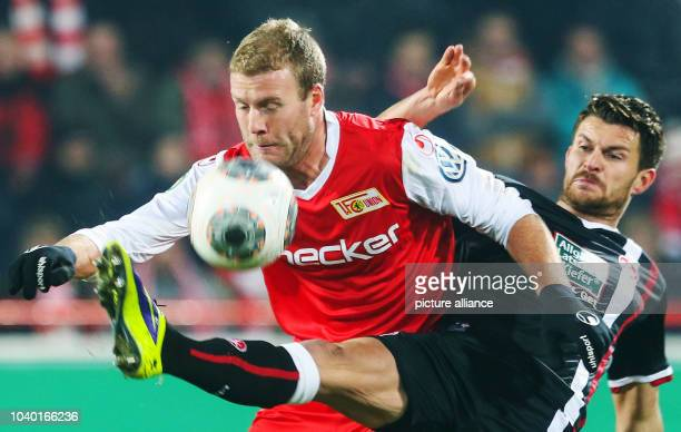 Union Berlin's Adam Nemec vies for the ball with Kaiserslautern's Enis Alushi during the round of 16 soccer match of the DFB cup between 1 FC Union...