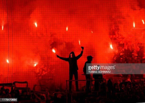 FC Union Berlin's fans light flares during the German first division Bundesliga football match between FC Union Berlin and Hertha Berlin on November...