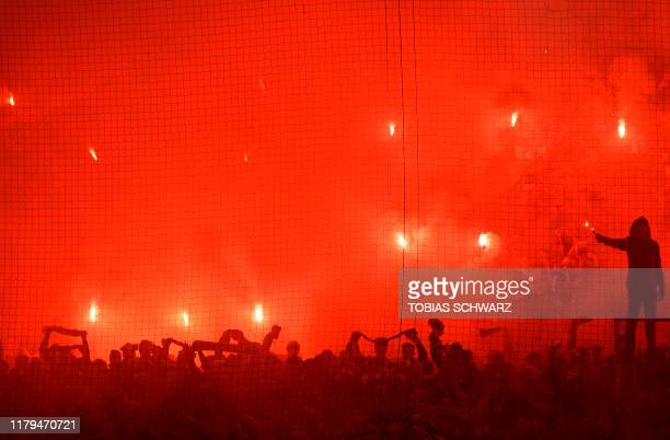 Union Berlin's fans light flares during the German first division Bundesliga football match between FC Union Berlin and Hertha Berlin on November 2...
