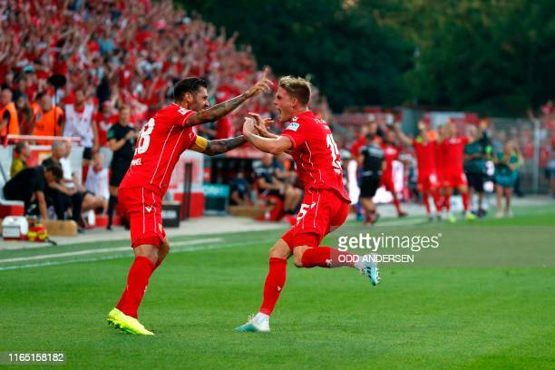 Union Berlin's German forward Marius Buelter celebrates scoring 10 with Union Berlin's Austrian defender Christopher Trimmel during the German first...