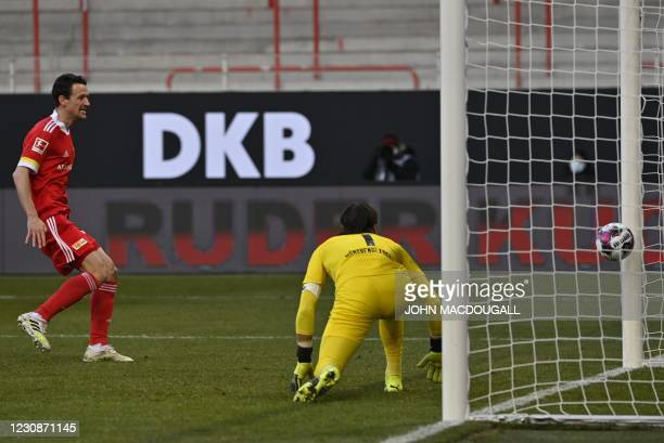 Union Berlin's German midfielder Christian Gentner looks on as Union Berlin's German defender Robin Knoche scores past Moenchengladbach's Swiss...