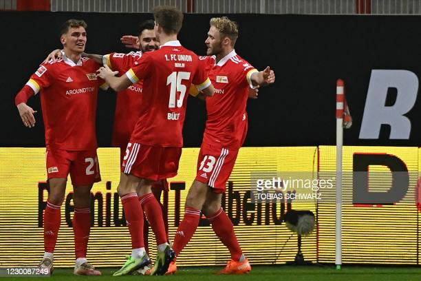 Union Berlin's German midfielder Grischa Proemel celebrates scoring the opening goal with his teammates during the German first division Bundesliga...