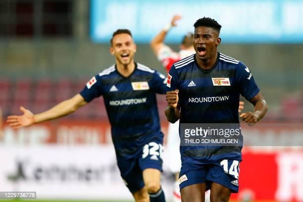 Union Berlin's Nigerian forward Taiwo Awoniyi celebrates scoring the opening goal with his teammates during the German first division Bundesliga...