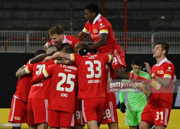 Union Berlin's players celebrate after Union Berlin's German midfielder Robert Andrich scored during the German first division Bundesliga football...